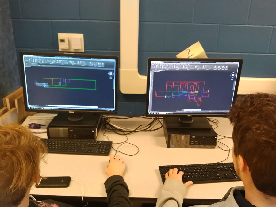 Students use drafting software to layout school bus conversions.