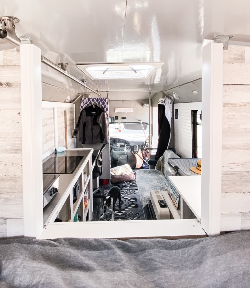 DIY shuttle Bus conversion front view from bed Nomad Brad