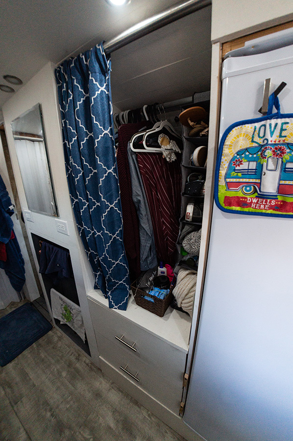 clothing closet storage bus conversion home on wheels aimless travels