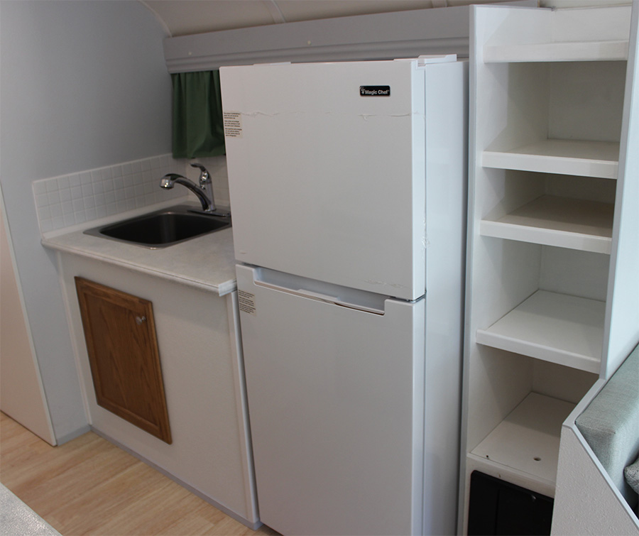 larger fridge skoolie interior